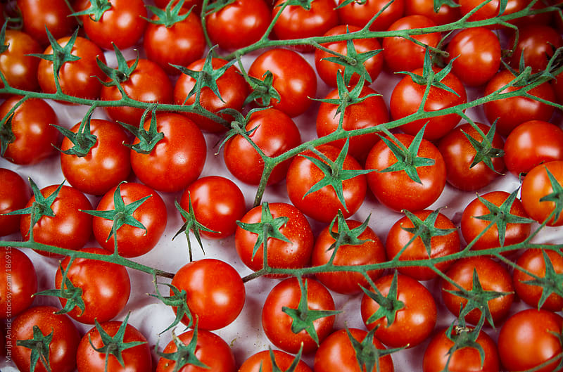 Cherry tomatoes on the market by Marija Anicic for Stocksy United