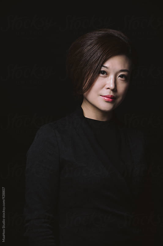 Portrait of young Chinese woman by Maa Hoo for Stocksy United