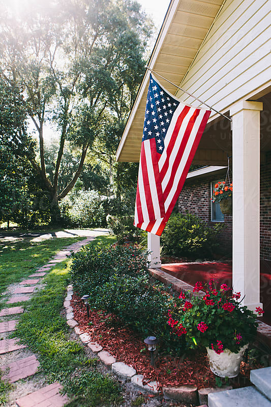 US Flag on Front Porch by Stephen Morris for Stocksy United