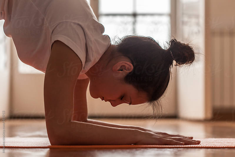 Close Up of a Woman in Yoga Posture by Mosuno for Stocksy United