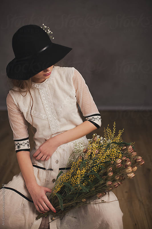 Girl with flowers by Ani Dimi for Stocksy United