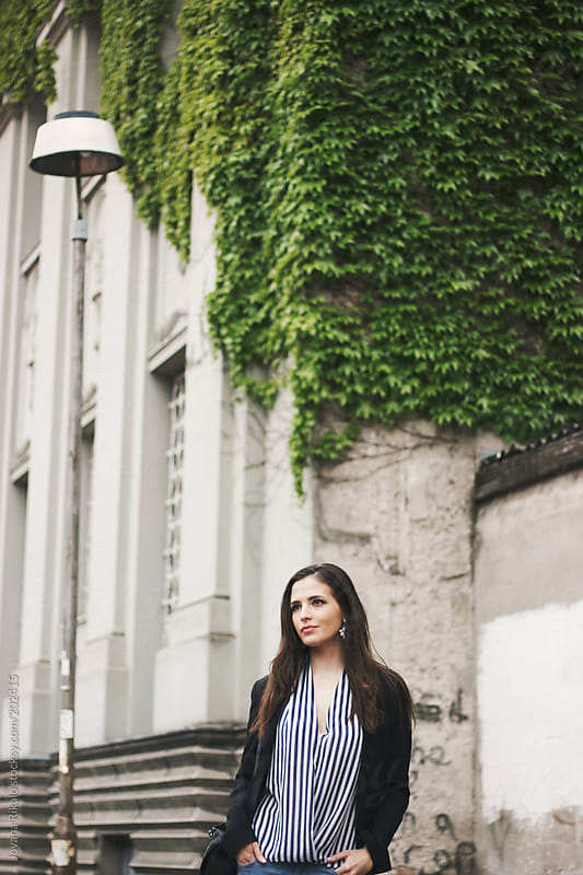 Young business woman standing on a street by Jovana Rikalo for Stocksy United