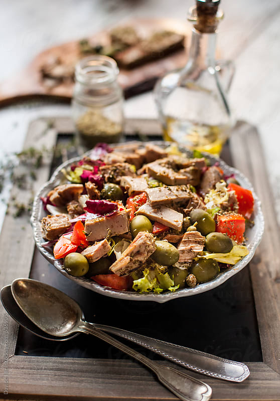 Mediterranean salad with tuna, olives and tomatoes by Davide Illini for Stocksy United