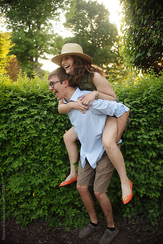 A couple on a piggyback ride by Chelsea Victoria for Stocksy United