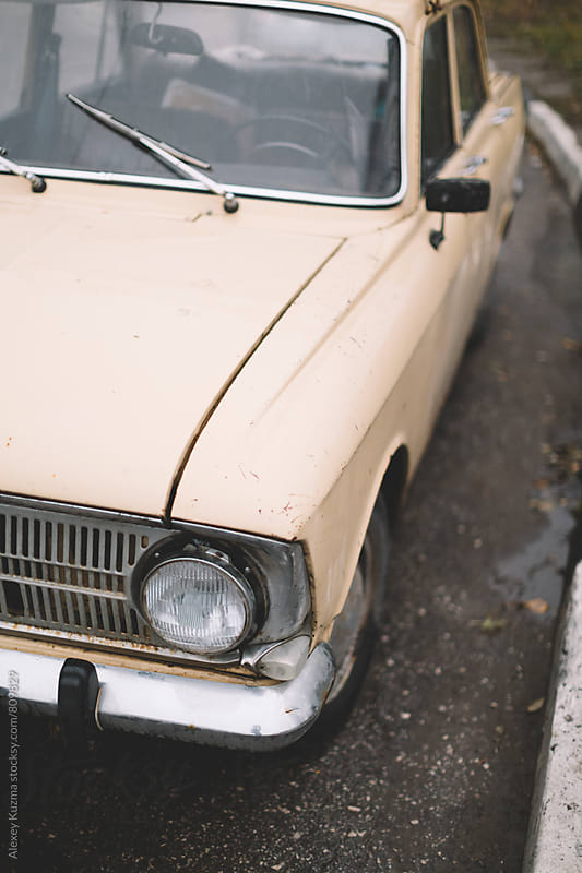 wet classic vintage car by Alexey Kuzma for Stocksy United