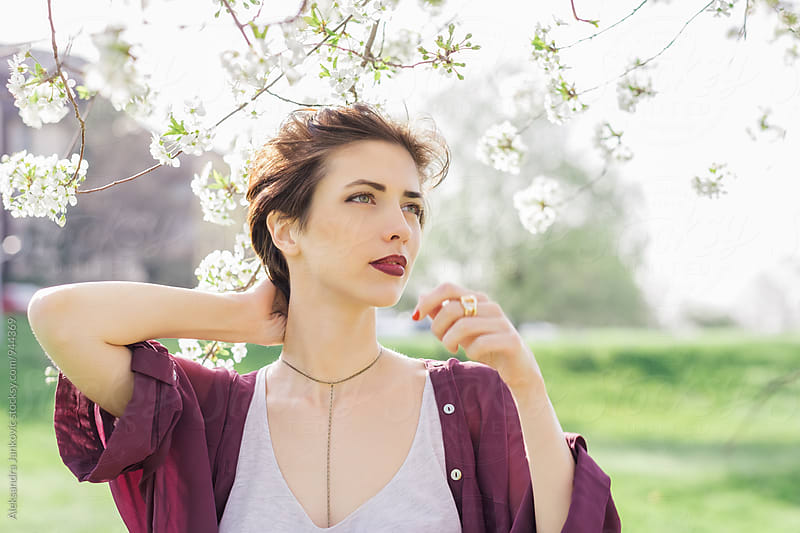 Portrait of a Beautiful Short-Haired Brunette Woman in the Springtime by Aleksandra Jankovic for Stocksy United
