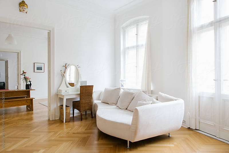 White Living Room in Bright Stylish City Apartment by VISUALSPECTRUM for Stocksy United
