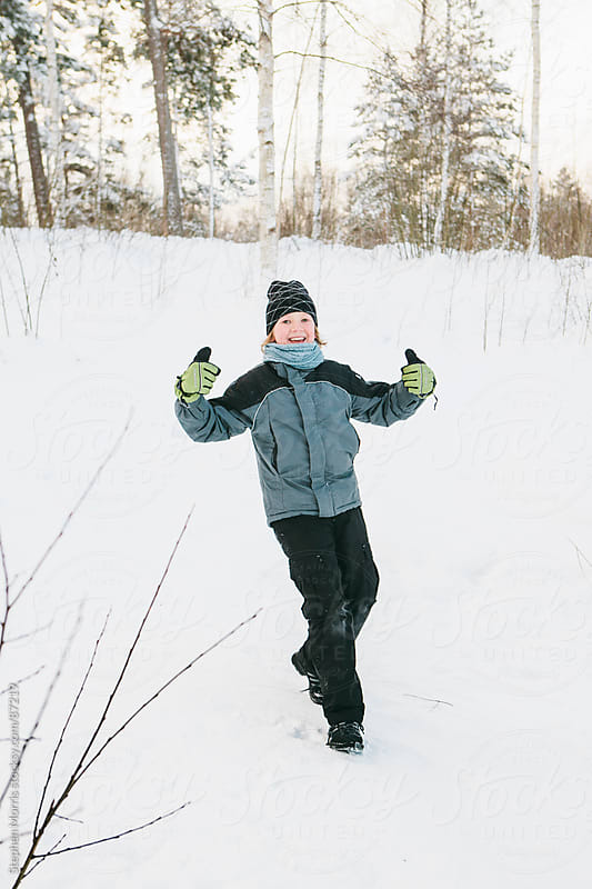 Happy boy in snow by Stephen Morris for Stocksy United