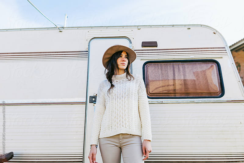 Woman farmer standing in front of a caravan. by BONNINSTUDIO for Stocksy United