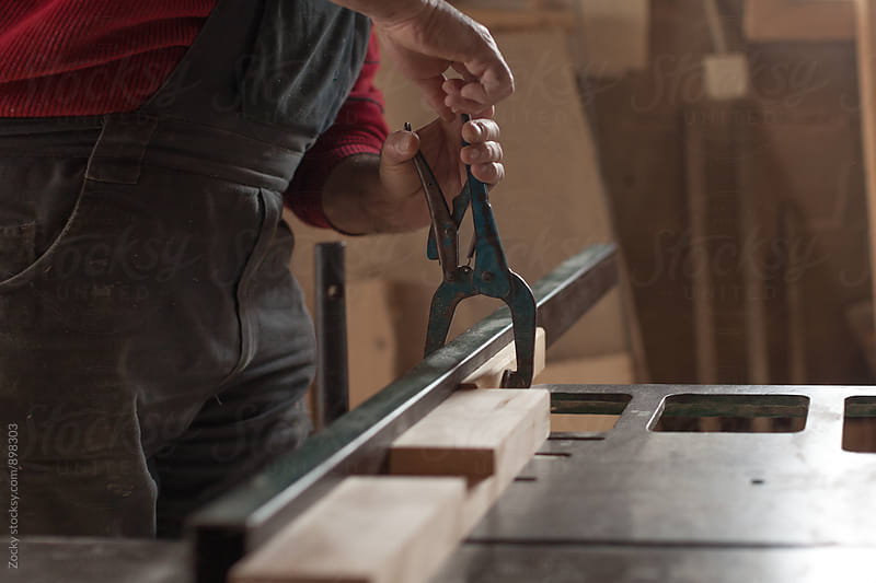 Carpenter working in his workshop by Zocky for Stocksy United