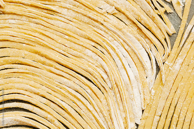 horizontal image of homemade, uncooked pasta by Kelly Knox for Stocksy United