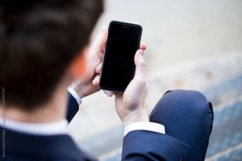 Businessman on his phone by Ann-Sophie Fjelloe-Jensen for Stocksy United