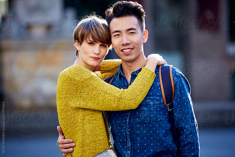 Loving Couple Embracing In City by ALTO IMAGES for Stocksy United