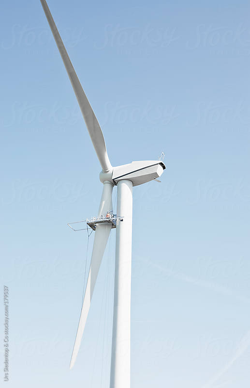 Repairing a wind turbine by Urs Siedentop & Co for Stocksy United