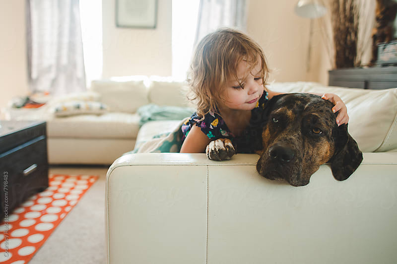 A girl and her dog by Courtney Rust for Stocksy United
