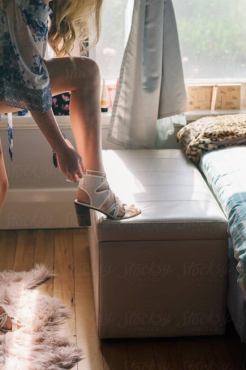 Teen Girl In Her Bedroom Putting On High Heels By Gillian
