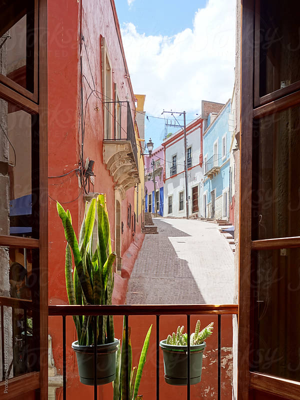 Window view of colorful alley in Guanajuato, Mexico by Per Swantesson for Stocksy United