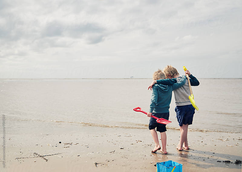 Two little boys on the beach by sally anscombe for Stocksy United