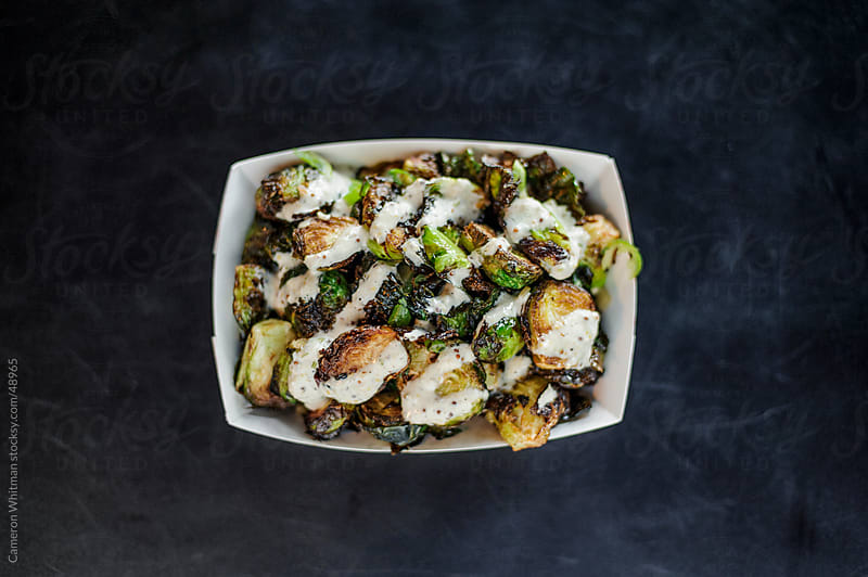 Bar Food: Brussel Sprouts topped with horse radish sauce  by Cameron Whitman for Stocksy United