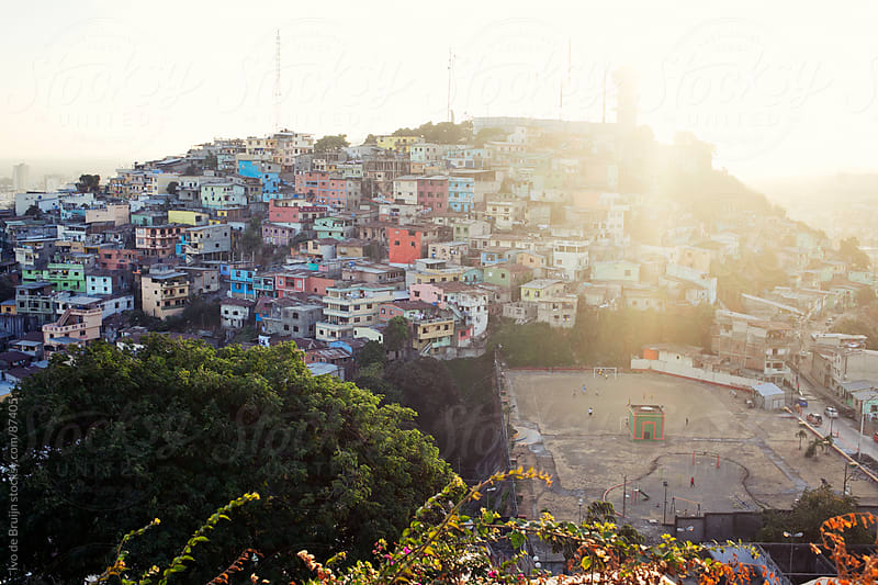 Colourful slums on a hill during sunset by Ivo de Bruijn for Stocksy United