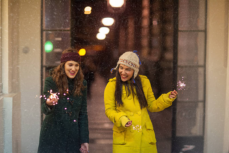 Friends Having Fun With Sparklers by Mosuno for Stocksy United