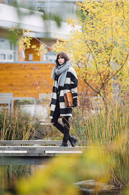 Wearing a striped jacket in autumn by Ania Boniecka for Stocksy United