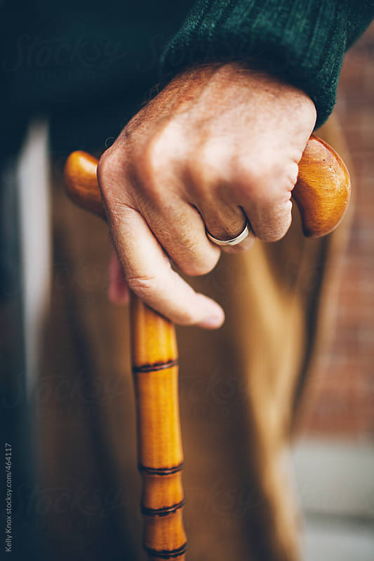 man's hand on his cane by Kelly Knox for Stocksy United
