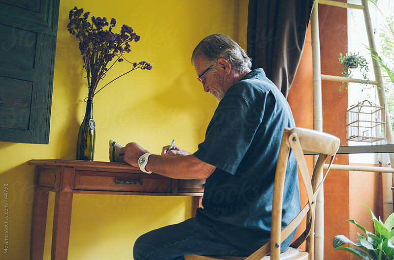 Older Man Writing at Home by Mosuno for Stocksy United