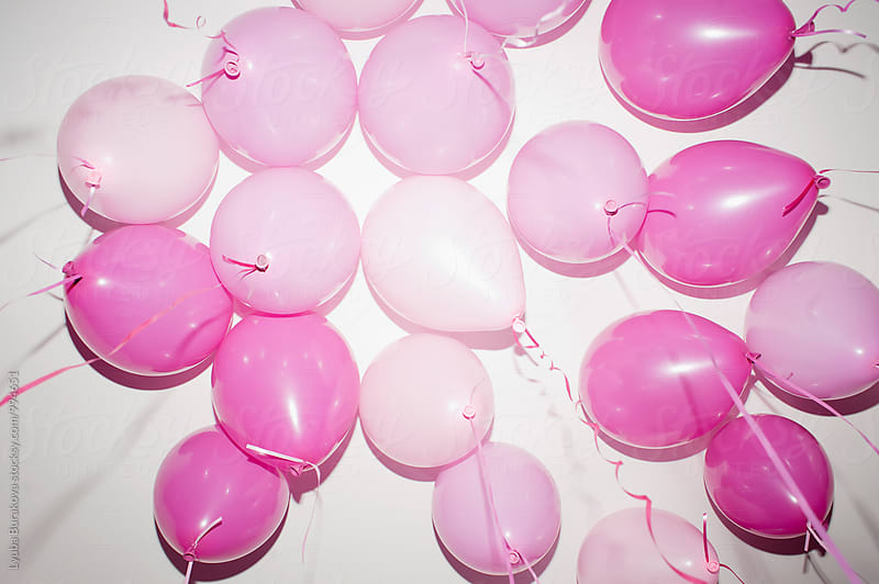 Pink balloons from below by Lyuba Burakova for Stocksy United
