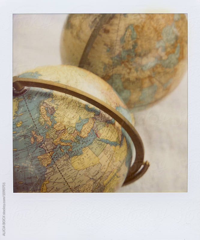 Polaroid Photograph Of A Vintage Globes by ALICIA BOCK for Stocksy United