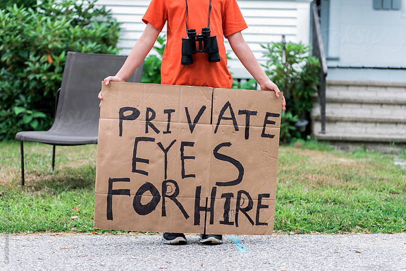 Child holds handmade Private Eyes for Hire sign by Cara Dolan for Stocksy United