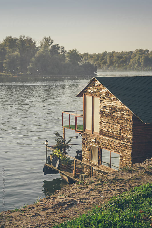 Wooden raft house on the river by Aleksandra Jankovic for Stocksy United