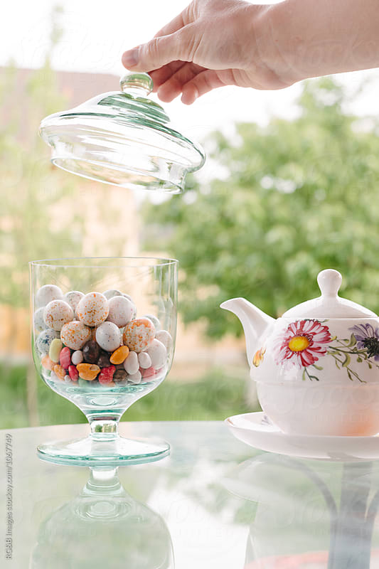 Tea break and candy in the garden by RG&B Images for Stocksy United