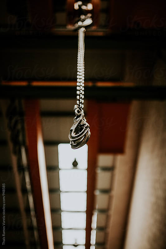 hanging chain by Thais Ramos Varela for Stocksy United