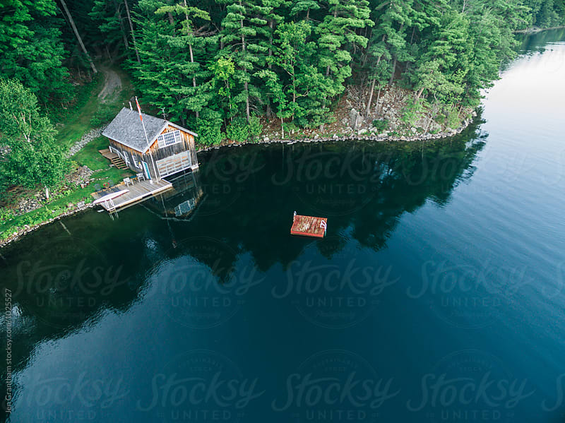 Boat house and raft by Jen Grantham for Stocksy United