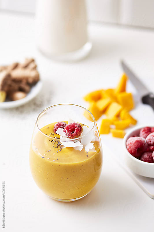 Fruit smoothie with chia and raspberry by Martí Sans for Stocksy United