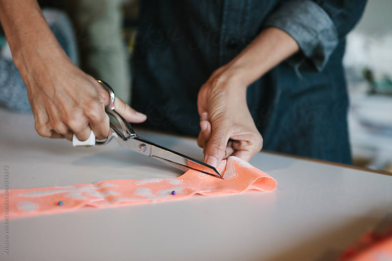 Womans Hands Working with Fabric by We Are SISU for Stocksy United