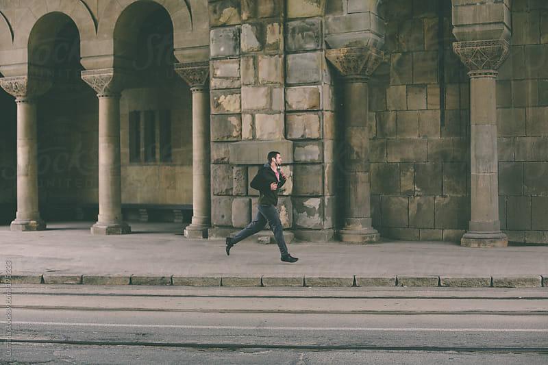 Man Running on the Street by Lumina for Stocksy United