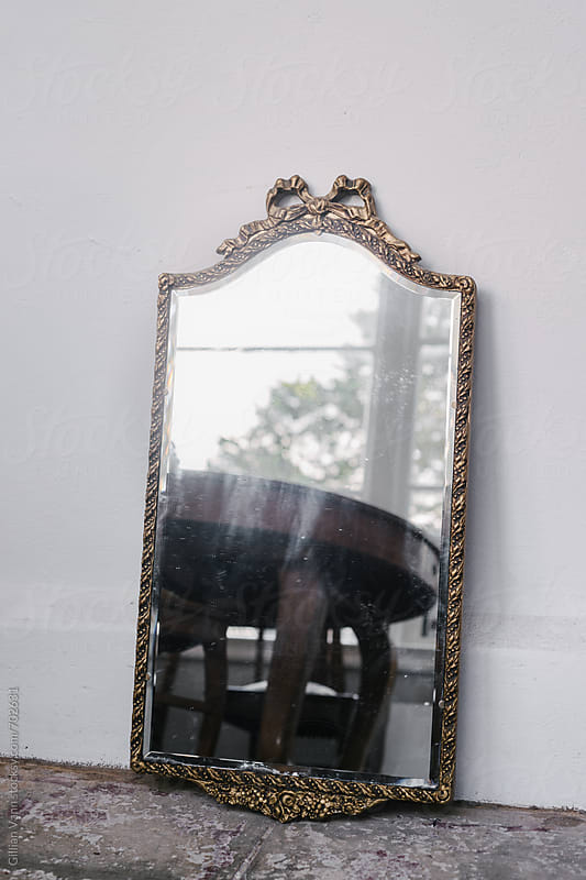 diy project: giving an old mirror a new look, the before shot by Gillian Vann for Stocksy United