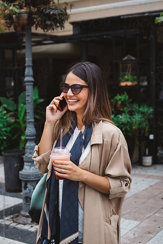 Pretty Brunette Woman Talking on the Phone  by Katarina Radovic for Stocksy United