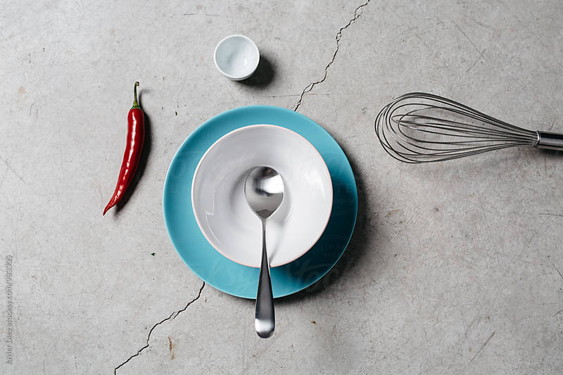 View on cement cracked table with kitchenware by Javier Díez for Stocksy United