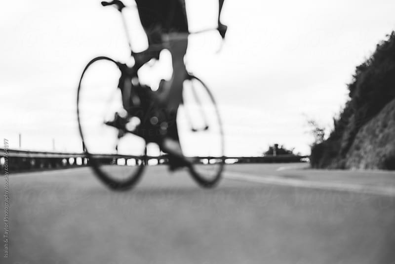 Detail of man riding a bike by Isaiah & Taylor Photography for Stocksy United