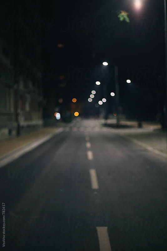 Empty street during the night. Blurry.  by Marija Mandic for Stocksy United