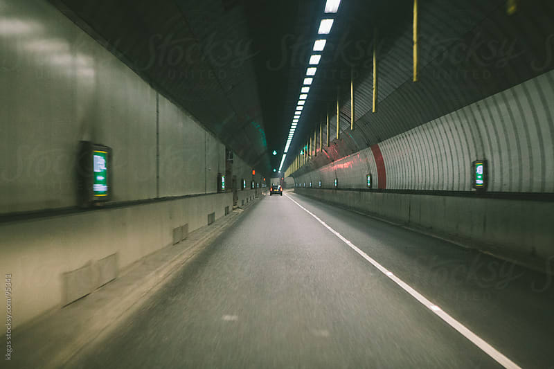 Car driving away in a tunnel by kkgas for Stocksy United