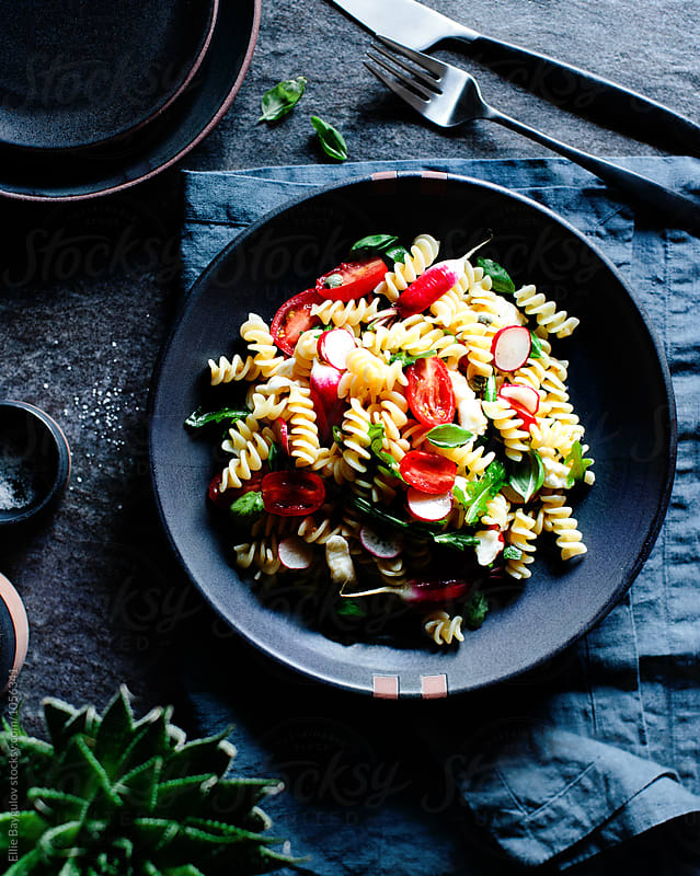 Tomato pasta salad by Ellie Baygulov for Stocksy United