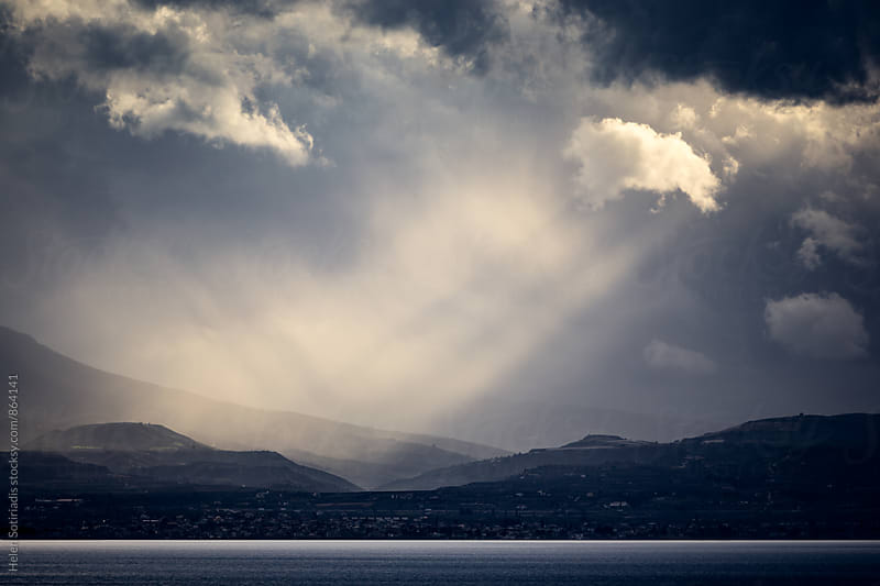 Sun Rays Through Turbulent Sky by Helen Sotiriadis for Stocksy United