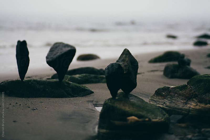 Balancing rocks on the beach. by Cherish Bryck for Stocksy United