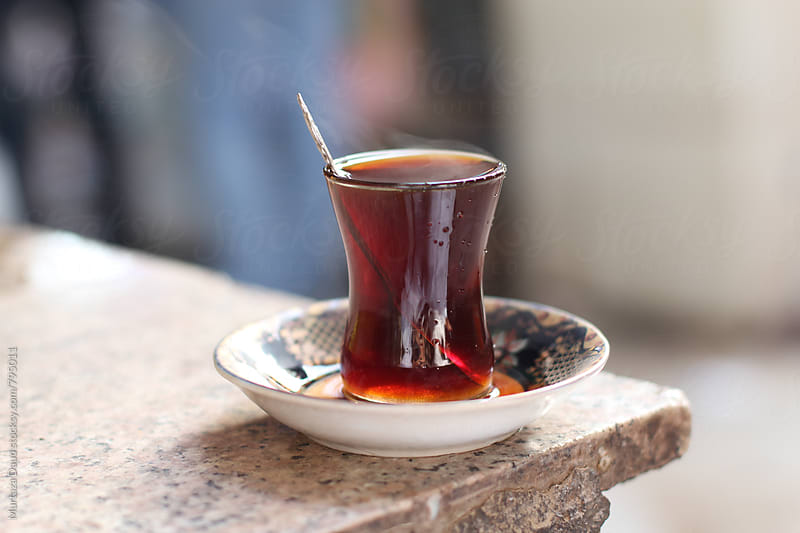 A cup of traditional Iraqi tea by Murtaza Daud for Stocksy United