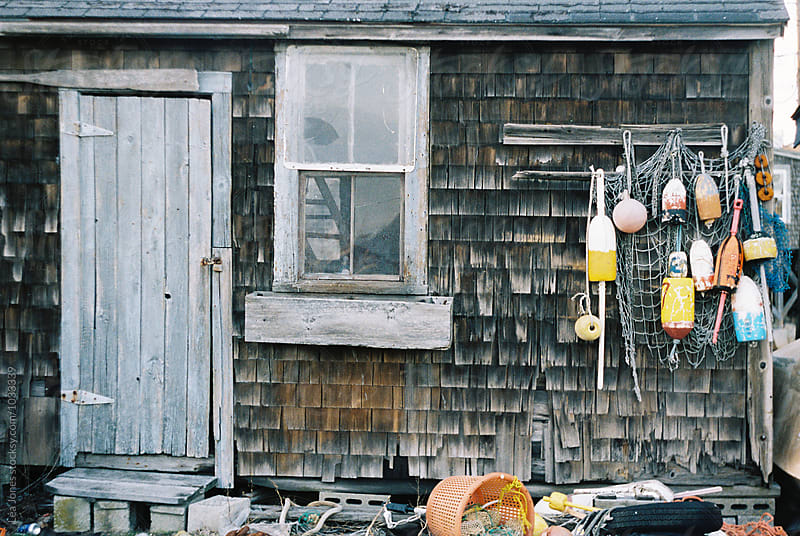 old fishing shacks with buoys  by Léa Jones for Stocksy United