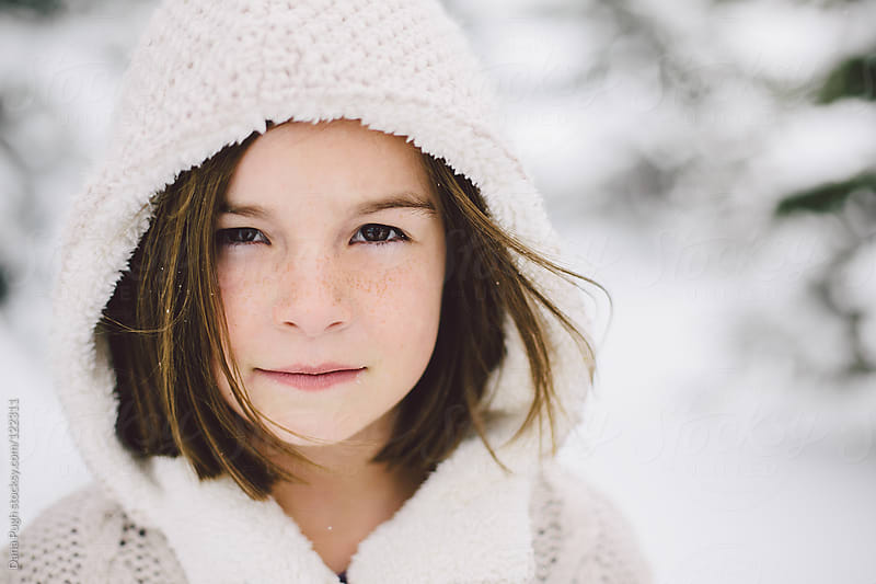 Girl Playing in the snow. by Dana Pugh for Stocksy United